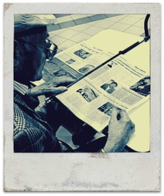 old man reading newspaper